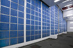 Detail of the back side of the front door of the aerospace paint booth with intake air filters in blue