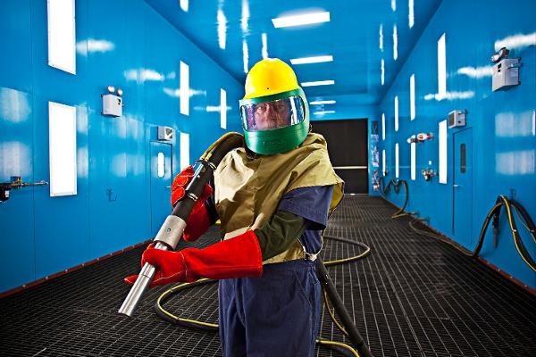 Blast Room Operator in Protective Gear